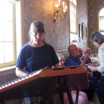 Playing dulcimer in the parish hall for Fr. John's retirement, July 2013.