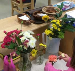 Flower arranging station with polishing and pouring visible on the shelf behind it.