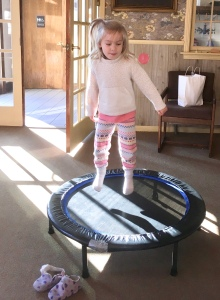 Girl on small trampoline.
